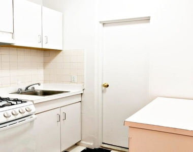 E 9th St. - Photo Thumbnail 2