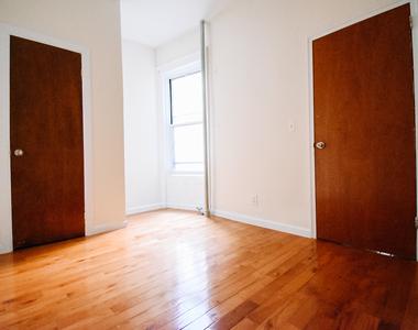W 111th St - Photo Thumbnail 3