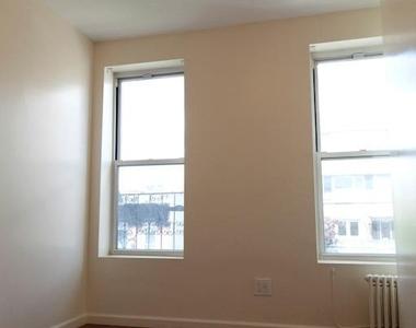 154 East 7th Street - Photo Thumbnail 0