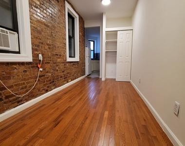 312 East 9th Street - Photo Thumbnail 0