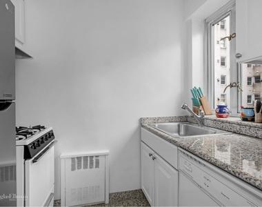 166 East 63rd St - Photo Thumbnail 2