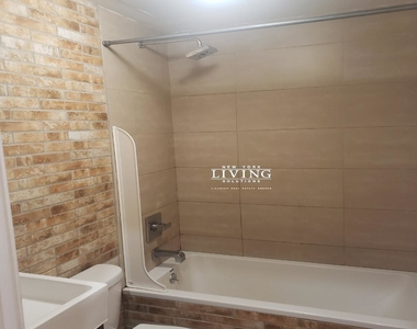 No Brokers fee + Free Rent + True 3 bedroom and 1.5 bath, Laundry in the building, Exposed brick wall, High Ceilings - Photo Thumbnail 3