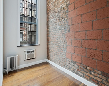 221 East 11th Street - Photo Thumbnail 4