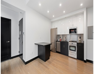 401 West 33rd Street - Photo Thumbnail 0