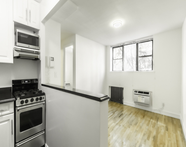 238 East 36th Street - Photo Thumbnail 0
