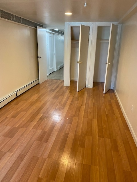 apartment listing photo of living space with open closets