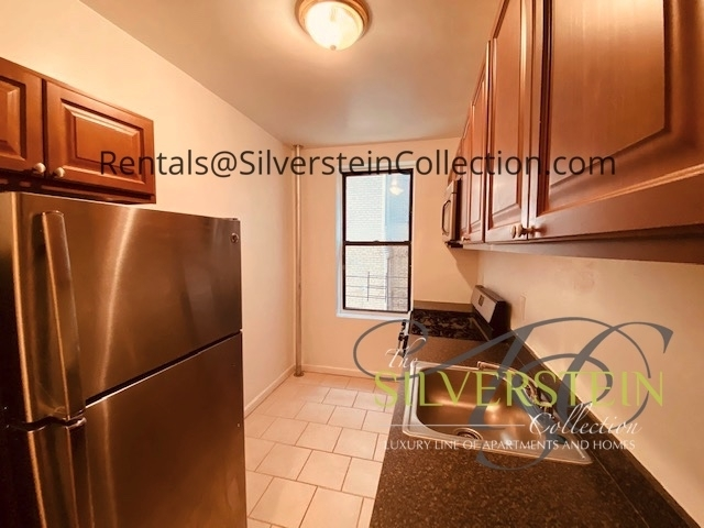 119-21 Metropolitan Avenue - Photo 1