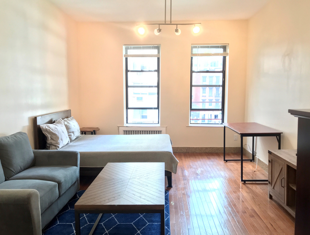 apartment photo of studio with bed and living space