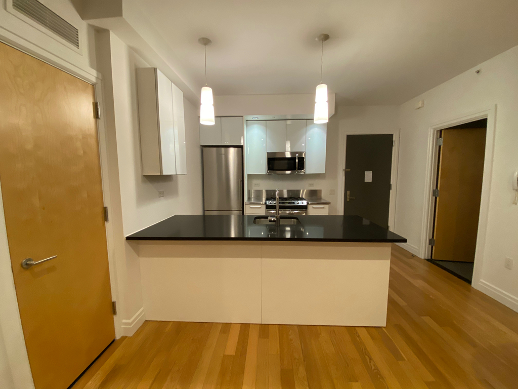 apartment photo with living space and kitchen
