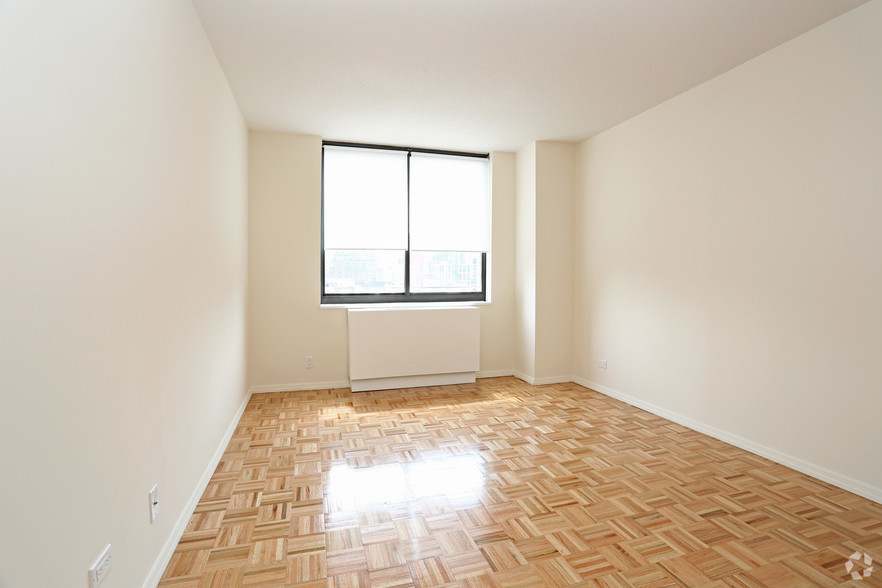 Lexington Ave 1BED CONVERTIBLE 2BED~FULL WALL ALLOWED~24 HR DRMN~POOL,GYM,SAUNA~6Train Close - Photo 4