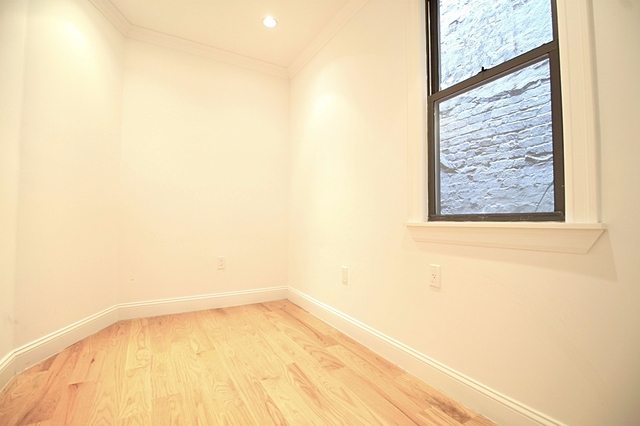2BR at 233 E 82nd St - Photo 6