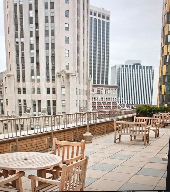 Studio, Financial District Rental in NYC for $7,100 - Photo 1