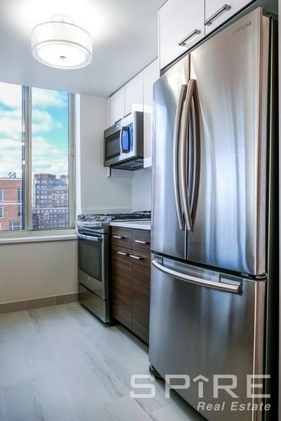 2 Bedrooms, Yorkville Rental in NYC for $6,899 - Photo 2