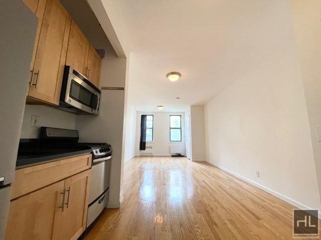 Studio, Yorkville Rental in NYC for $1,824 - Photo 1